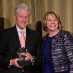 Clinton holding award
