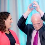 Jamie holding award